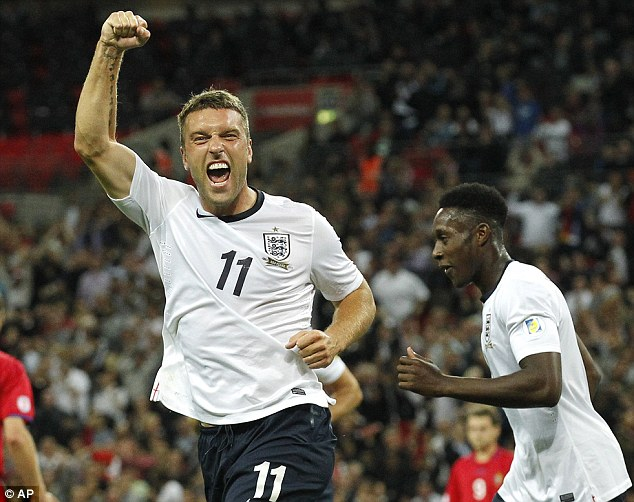 International honours: Lambert will be hoping to add to his two goals in four games for England in Brazil