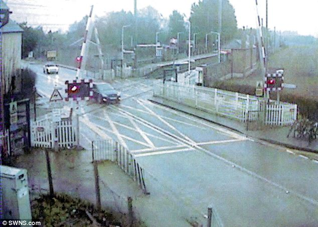 Warning: Lights on the crossing at Foxton, Cambridgeshire were flashing as McKenna crossed over the route, with the barrier starting to drop as he passed through