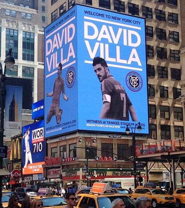 Stateside star: A billboard announcing Villa's signing looks over Time Square in New York