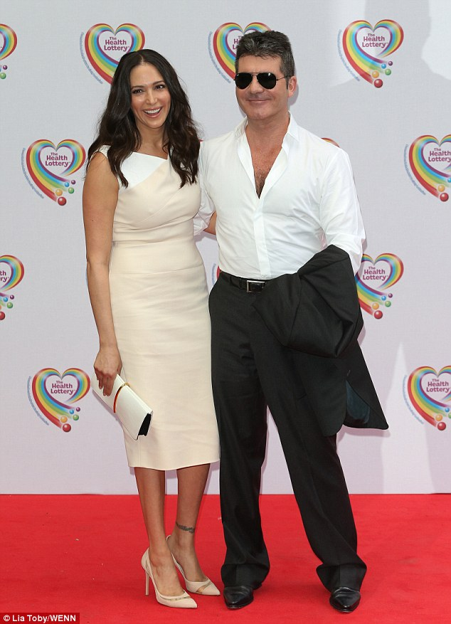 Doing his bit for charity: Simon was joined by his girlfriend Lauren Silverman as he attended the Health Lottery Tea Party held at The Savoy hotel on Monday