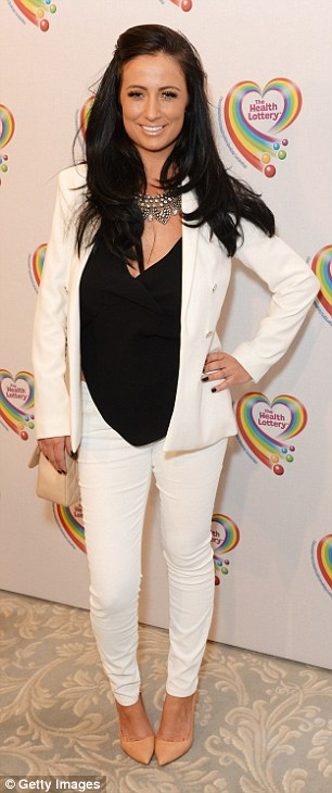 Stylish arrival: TV personality Chantelle Houghton looked chic as she wore a white trouser suit teamed with a black blouse while Casey Batchelor sported a girly style with a pink mini dress that featured white floral detail