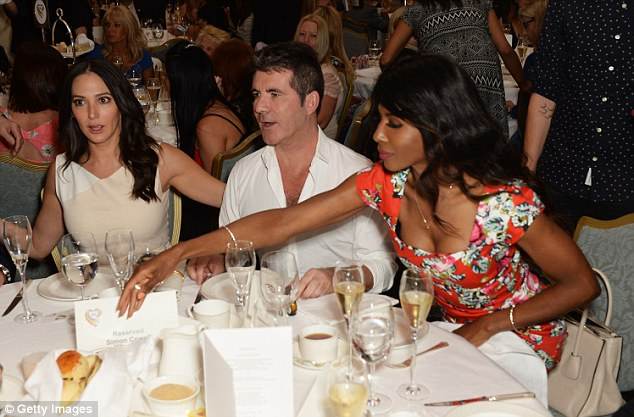 Good friends: Simon and Lauren were joined at their table by close friend, Sinitta