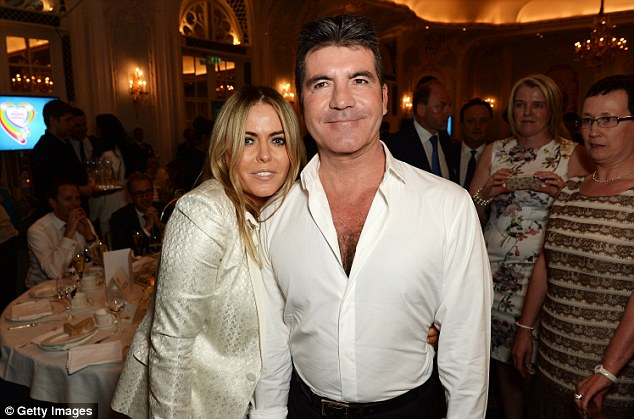 Friendly pair: Simon posed alongside actress Patsy Kensit inside the event