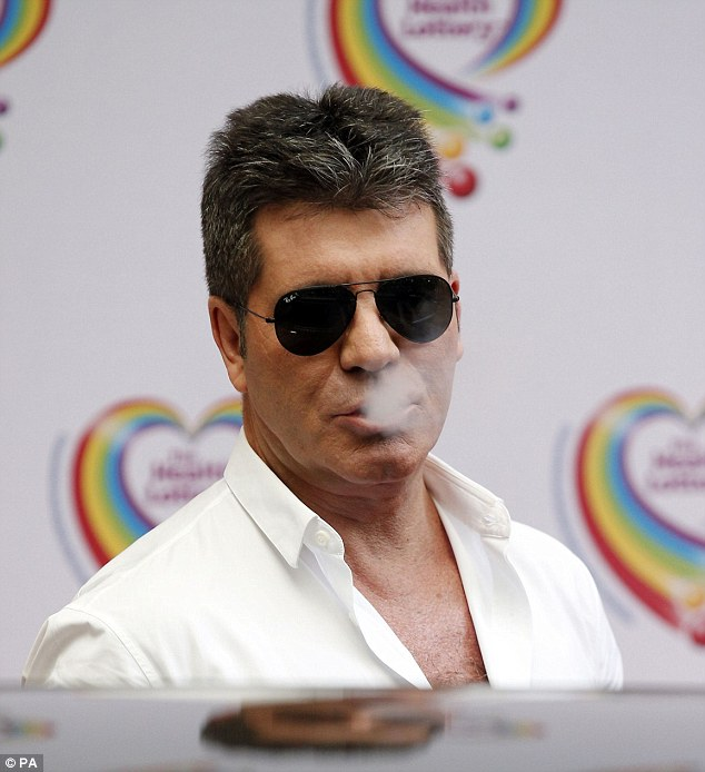 Not the best location: Simon Cowell has previously admitted his love of smoking