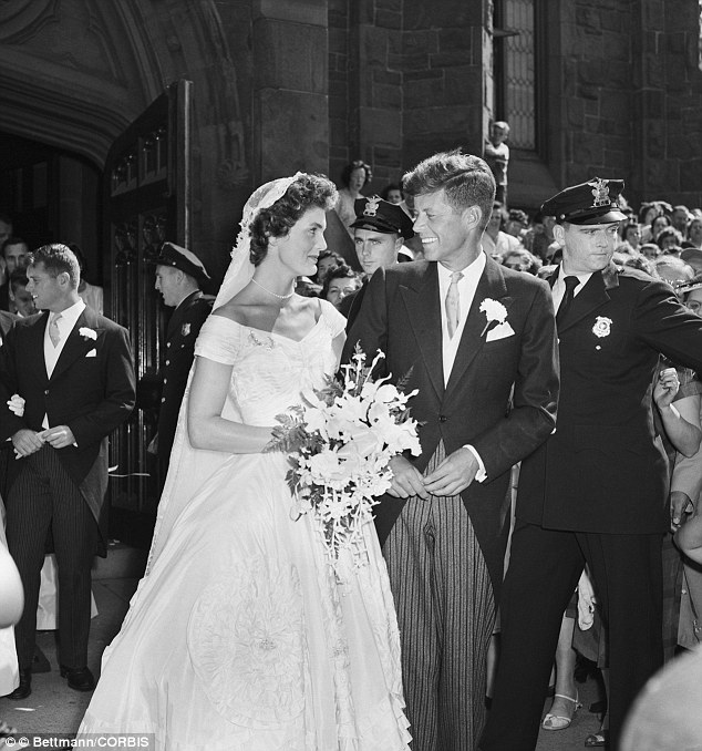 Wedding belle: Senator John F. Kennedy and Jacqueline Lee Bouvier, leave a Newport, Rhode Island, church following their wedding ceremony in 1953. An estimated one thousand people waited outside the church for the newlyweds. One of them was Bobby Kennedy, who would eventually become Jackie's lover