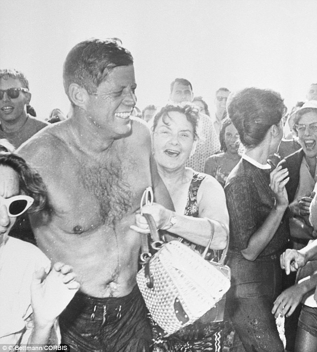 Body language: Women went gaga over the handsome president but when jackie saw him in swim trunks for the first time she remarked, 'He's no Burt Lancaster'