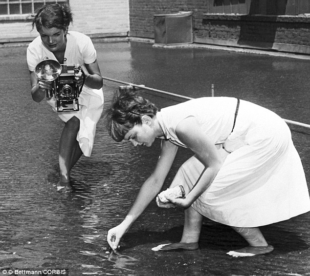 Go Fish: The future first Lady photographs Dale Chestnut feeding goldfish on the roof-top pond of the Washington Times-Herald building