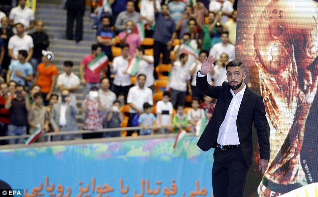 Send off: Dejagah waving goodbye at a farewell ceremony for the national team held in Tehran, Iran