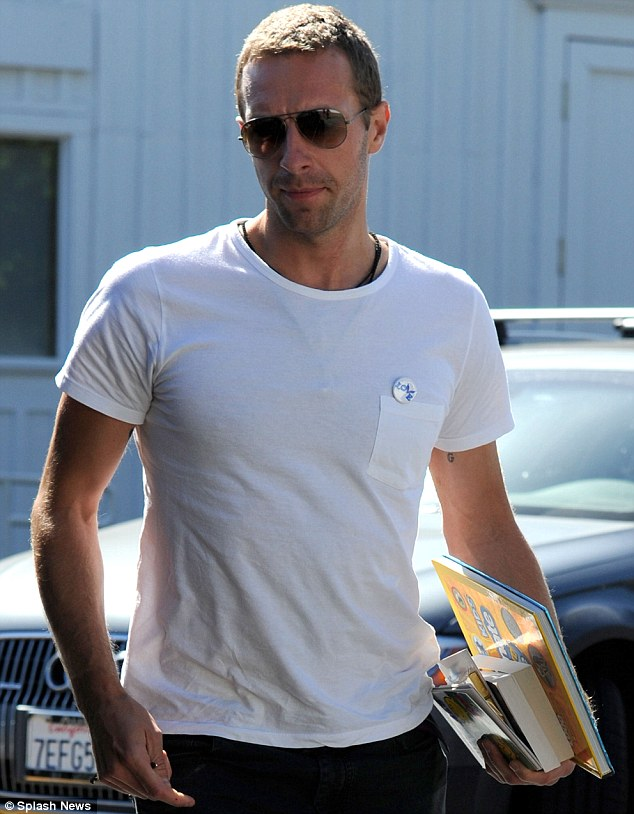 Badge of honour: Chris Martin stepped out wearing a familiar accessory in Los Angeles on Monday