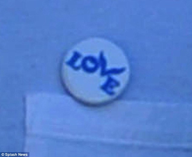 Pin-ing for Gwyneth? The badge was emblazoned with the word 'love' and he had worn it while at events with his estranged wife in the past