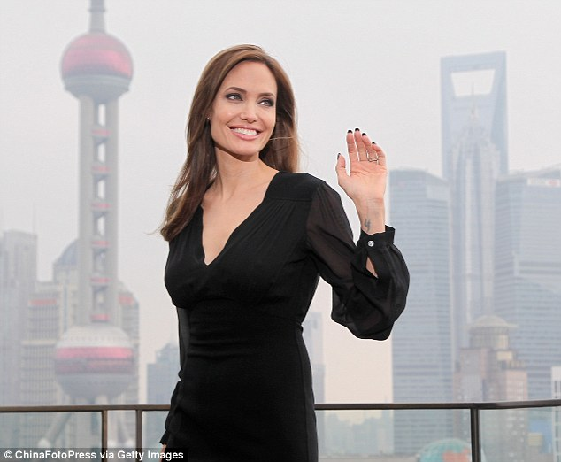 Shanghai surprise: Angelina kept it simple in a black dress with gold-effect shoes