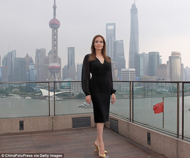 Glamorous: The star cut a stylish figure as she posed by the city's skyline