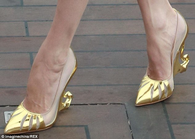 That's shoe-business! Angelina wore her specially-designed shoes to launch the fantasy film