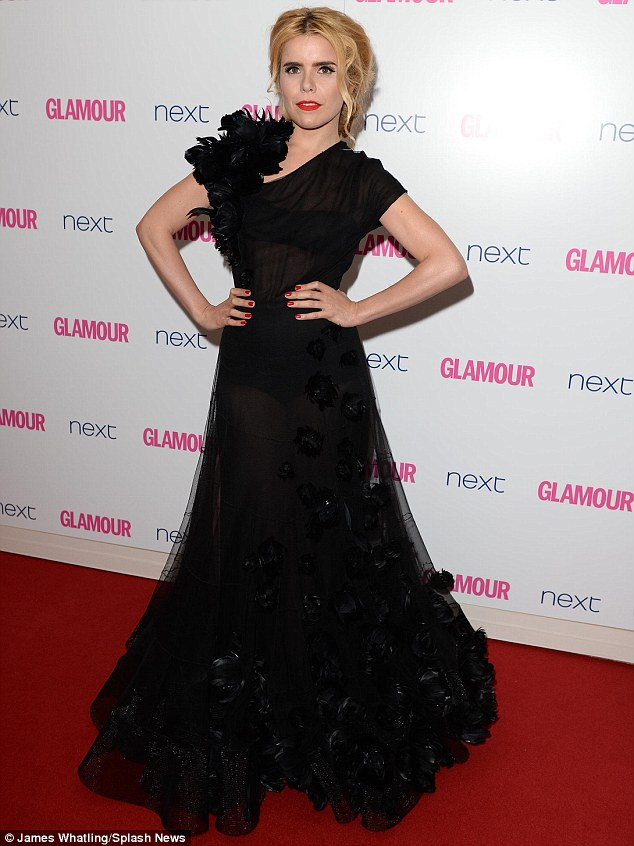 Beautiful: Paloma Faith stunned in a sheer black gown featuring floral detail on the skirt and shoulder