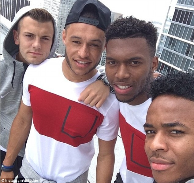 On top of the world: England stars (from left to right) Jack Wilshere, Alex Oxlade-Chamberlain, Daniel Sturridge and Raheem Sterling pose on top of their hotel in Miami