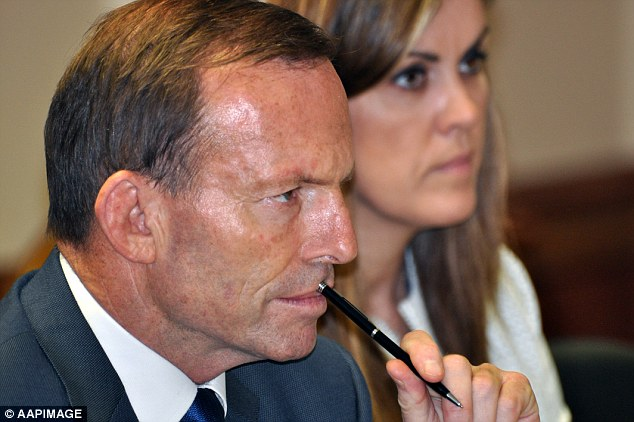 Politically close: Prime Minister Tony Abbott (pictured with Peta Credlin) is politically closest to his powerful chief of staff, who even members of his own party say he relies on heavily and respects her judgment
