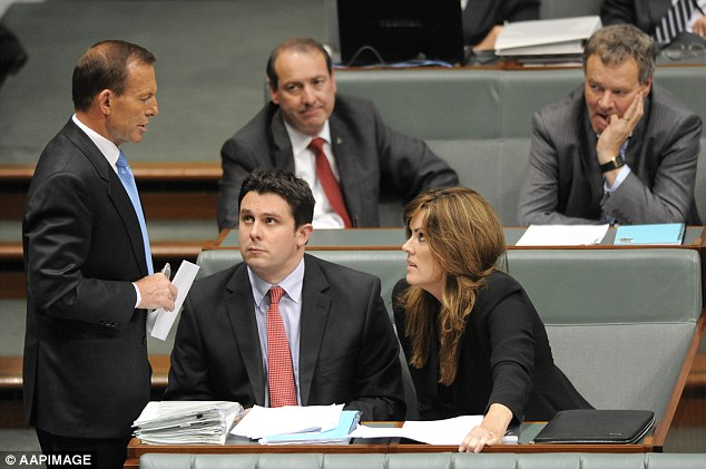 Time to question: MP Clive Palmer's criticism of Peta Credlin (pictured with Tony Abbott during question time in the House of Representatives) was that the influence she wields should not supersede that of MPs.  'I think policies should be formulated from the party room,' he said. 'It shouldn't come down from Tony Abbott's office telling elected members of parliament what they will do'