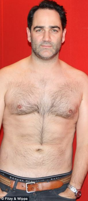 Poster man: Wippa shows off shirtless, svelte physique having shed 10kgs this year