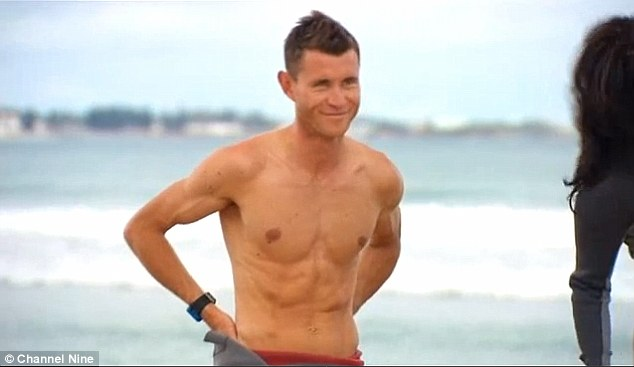Wet and wild: Charlie playfully stripped off during a trip to the beach with the contestants