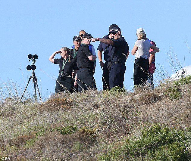Wide view: Police have focussed on this mound of land in the distance, which then runs down into the Atlantic