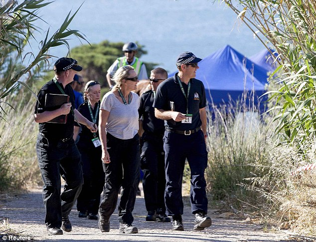 Heavy presence: At least 30 officers from the UK are overseeing the search in Portugal, including specialists from South Wales Police and Sussex Police
