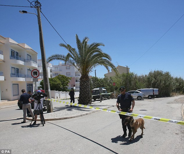 The police cordon starts at a junction of one of Praia da Luz's main roads - Rua 25 de Abril - named after the bloodless military coup in the country in 1974