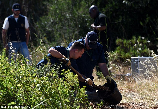 Probe: Police investigating the disappearance of British girl Madeleine McCann search the area of scrubland today, near the holiday apartment in Praia da Luz where she vanished seven years ago