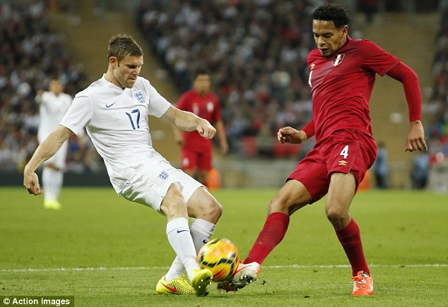 Crunch: Milner tackles Alexander Callens (right) during England's 3-0 win over Peru last week