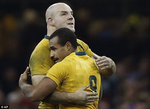 Axed: Genia gets a hug from Stephen Moore (left), who will captain Australia in the first test