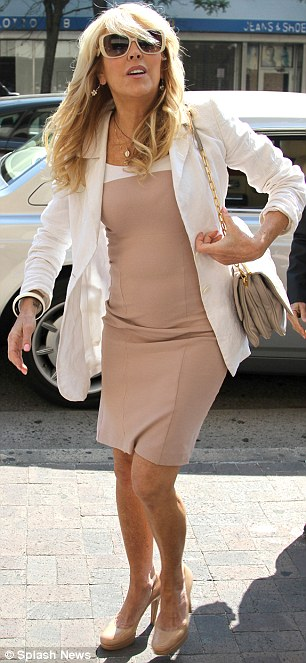 Facing the music: Dina arrived in court on Tuesday wearing a smart beige dress and a white jacket