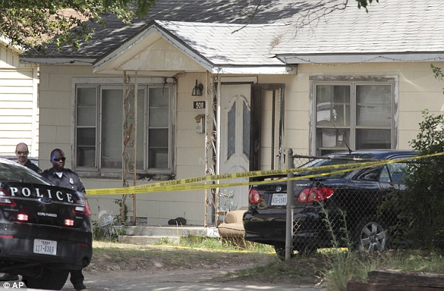 Crime scene: Police tape cordons off a Fort Worth home where the bodies of three women were found Tuesday morning