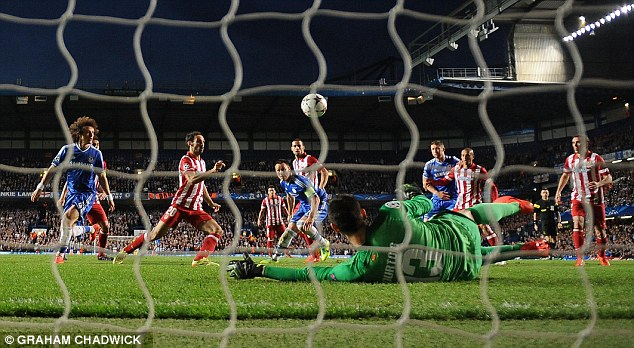 Friend or foe: Courtois makes a save during Atletico's 3-1 win over Chelsea in the Champions League semi-final