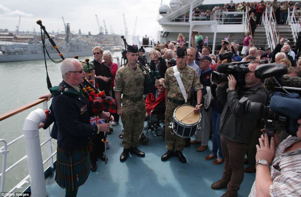 John Millin, 59, from Nottingham, plays the pipes as the ship sets off from Portsmouth. He is the son of the legendary piper Bill Millin, who defied orders and took his bagpipes to D-Day to play as gun fire rang out around him to lift the spirits of troops invading Sword Beach
