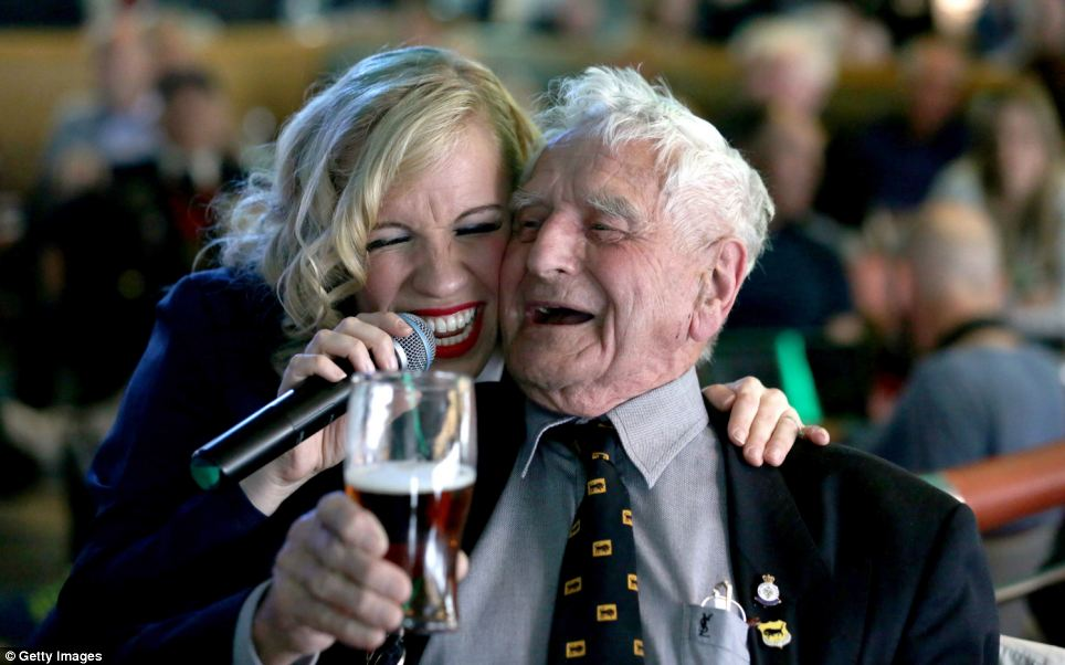 Wartime spirit: Bill Pendell, 92, who landed on Gold Beach with the 11th Armoured Division, is pictured with Candy Girl Debbie Watt yesterday