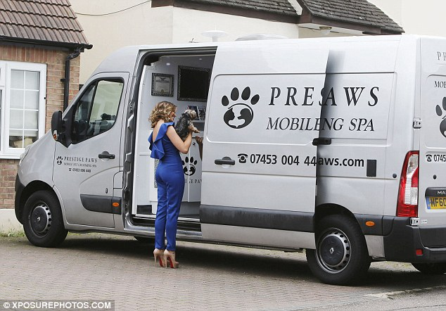 Lucky girl: The TOWIE star looked thrilled as she took Bella into the van for a few treats