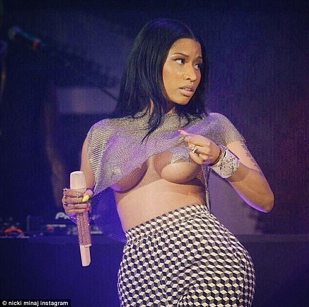 If you've got it, flaunt it! Nicky Minaj gave concertgoers an eyeful at Sunday's Summer Jam hip-hop music festival in New Jersey as she lifted up her sheer silver top to reveal her exposed breasts, covered only by silver star-shaped nipple pasties