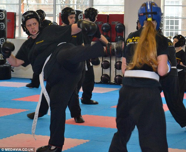 In December 2011, nearly two years after first taking up the sport, Miss Staunton proudly received her black belt in kickboxing