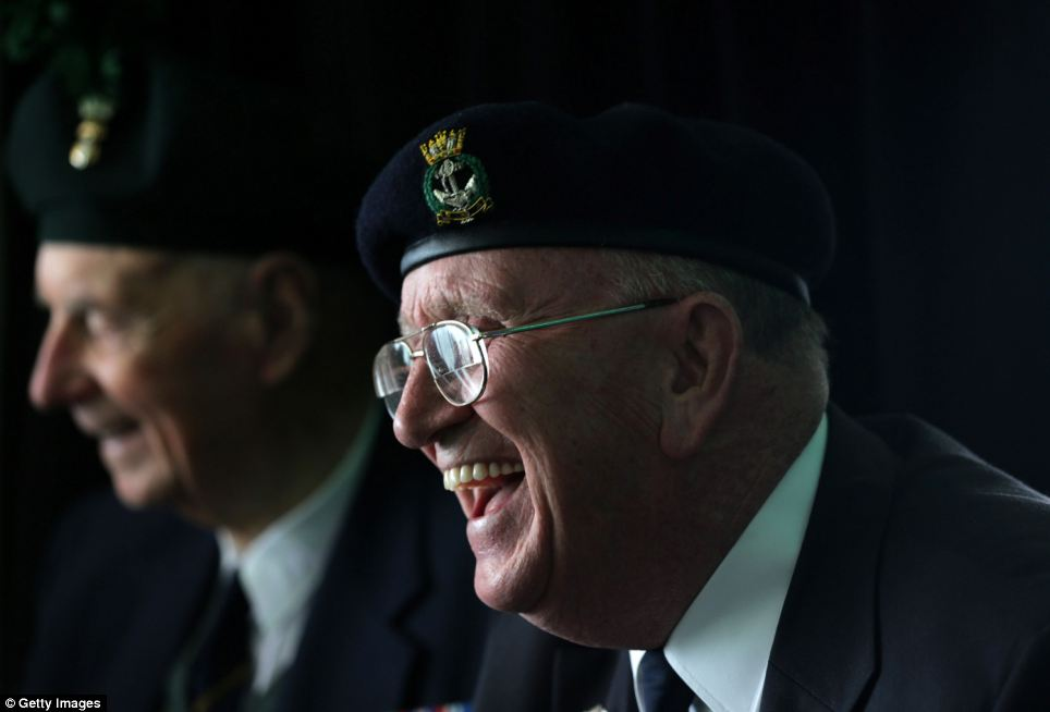 Bert James, 90, shares a joke with other veterans ahead of the 70th anniversary of the landings, in which 156,000 allied troops were involved