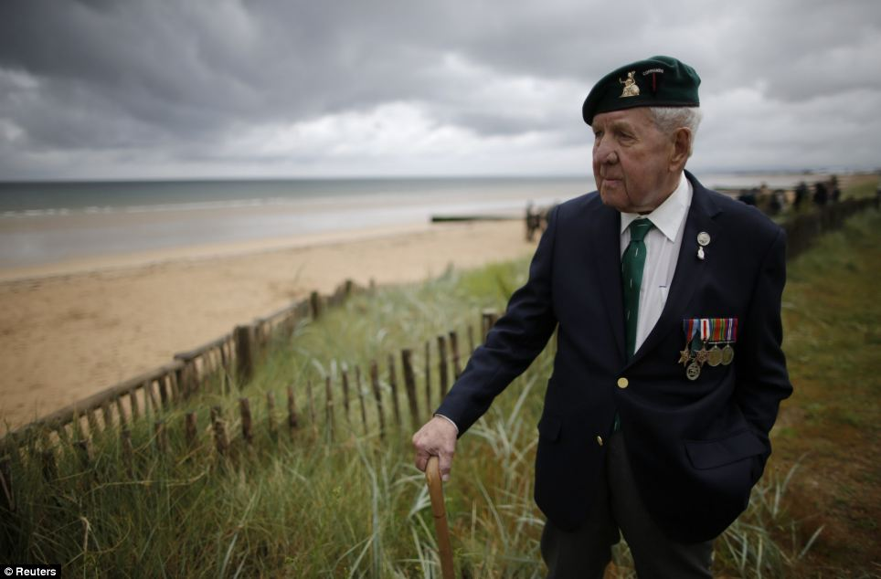 Herbert Beddows, 92, who served with three different commandos and landed on Sword Beach on June 6, 1944, poses on the beach front outside Colleville-Montgomery