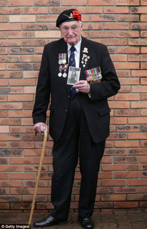 John Ainsworth, 93, who was in the Royal Artillery, brought a photograph of himself taken in 1940 to show locals and former comrades during the celebrations
