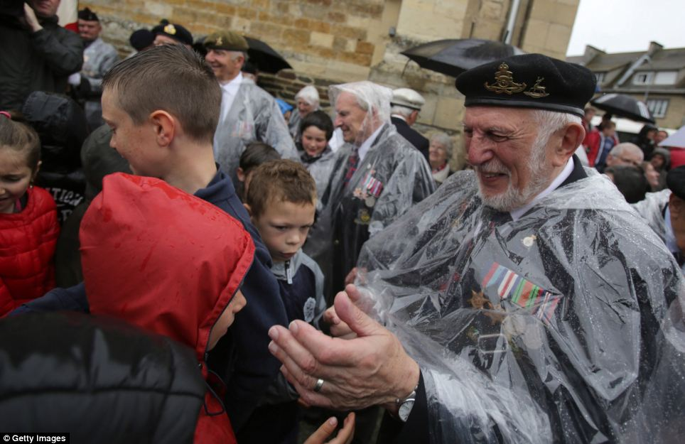 Joe Cattini, 91, who was in the Herefordshire Yeomanry on Gold Beach on D-Day, thanks local schoolchildren after they welcomed veterans to their town by singing 'God Save The Queen'