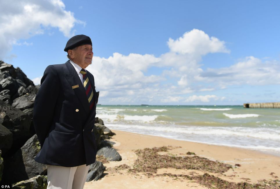 Veteran Harry Mason, 95, from Warrington, looks out from the beach at Arromanches and the remains of Mulberry Harbour where he landed with British forces seventy years ago