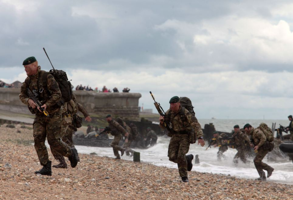 The Marines sprinted up the beach in final rehearsals for the gripping reenactment - due to be shown during anniversary celebrations today