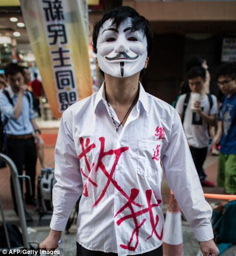 A man wears a mask and poses as a victim to commemorate China's 1989 Tiananmen Square events ahead of a candlelight vigil in Hong Kong