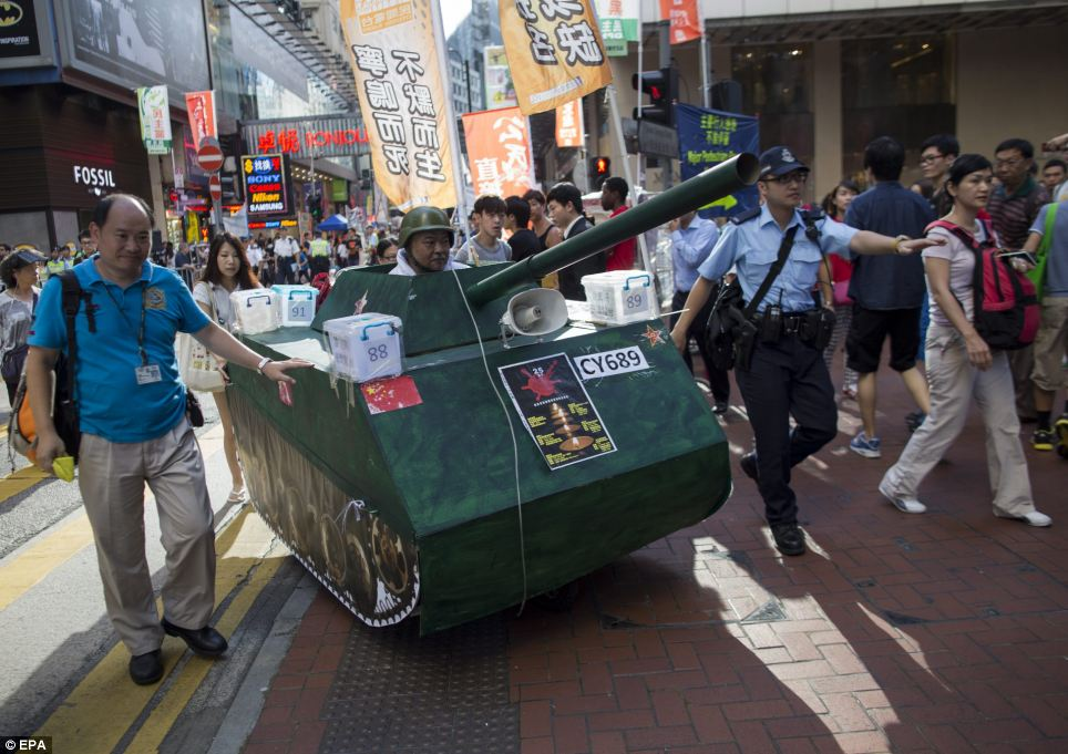 A man in a mock People's Liberation Army tank makes his way towards Victoria Park to attend the 25th anniversary of the Tiananmen Square crackdown