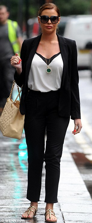 Monochrome magic: Jess slipped into an effortlessly elegant black and white ensemble as she headed out in Knightsbridge, London, on Wednesday afternoon