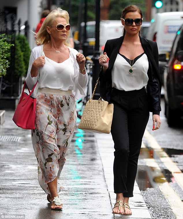 Mum's the word: Jess was joined by her co-star mother Carol as they headed off to the Tracie Giles salon for the day