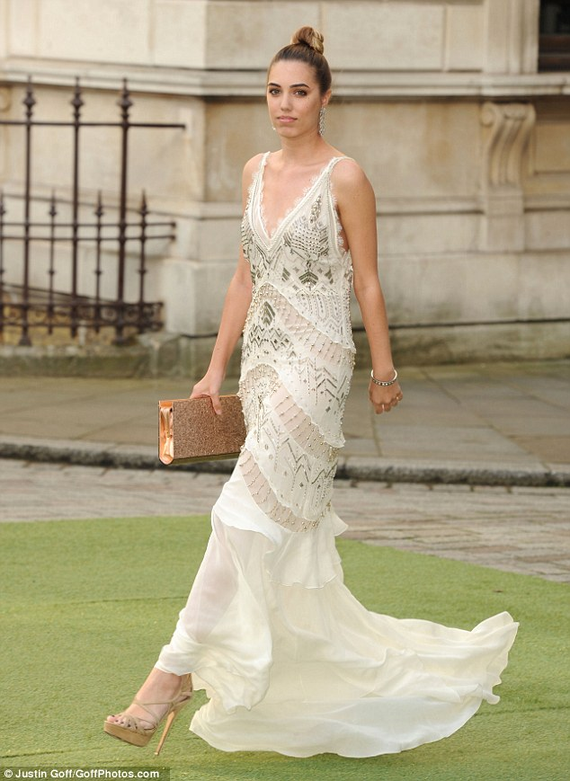 Elegant: Model Amber Le Bon channelled 1940s glamour as she arrived in a floaty beaded Roberto Cavalli dress which featured sheer inserts