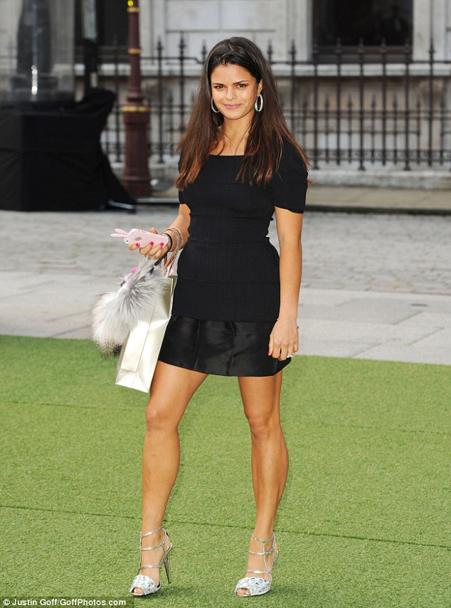 The classic LBD: Fashion blogger Bip Ling opted a black mini dress which she teamed with silver peep-toe heels