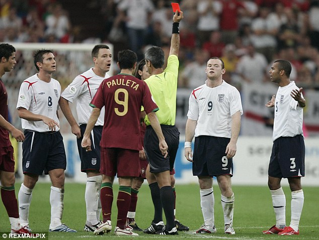 Red mist: Wayne Rooney (second right) reacts incredulously to being sent off against Portugal